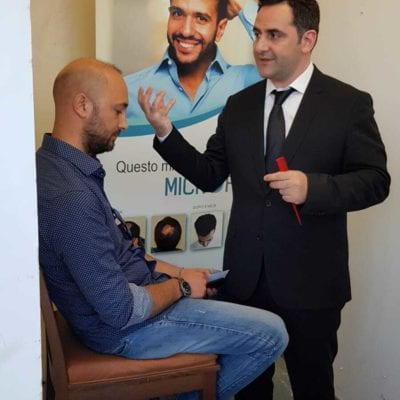 Doctor Levent Acar performing a hair analysis