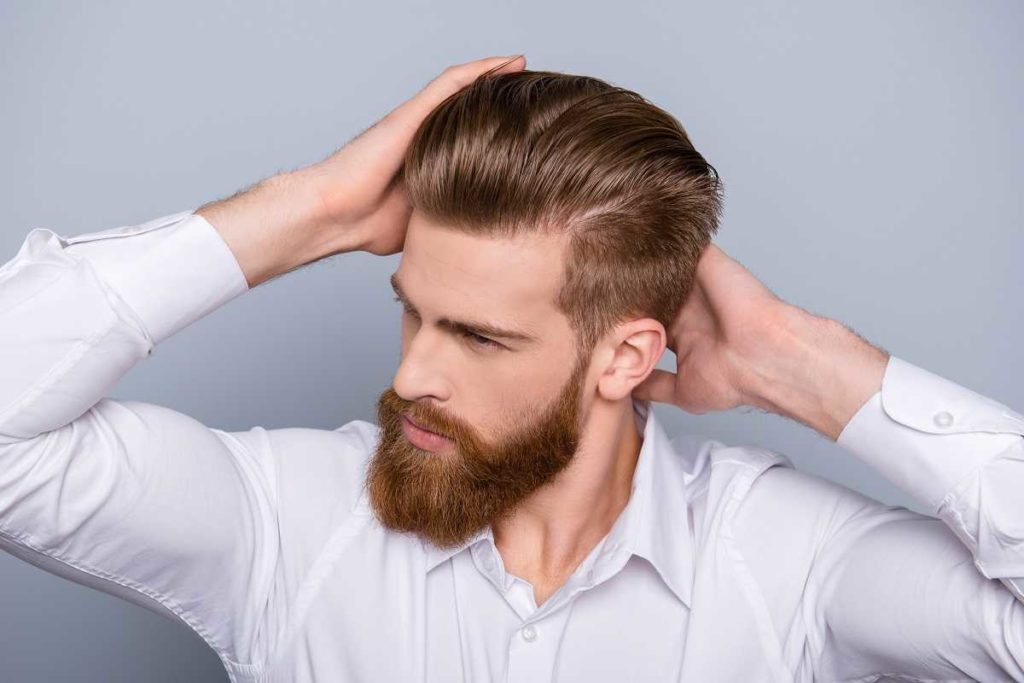man with full hair and full beard
